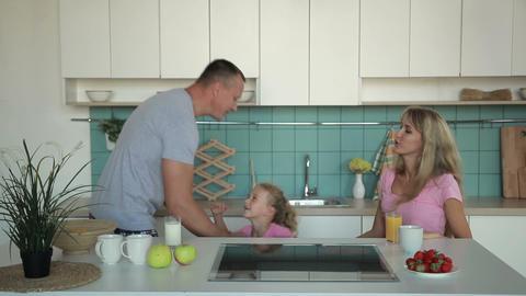 Happy family having breakfast in the morning Archivo