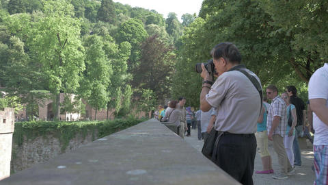 Old asian tourist taking photos of an ancient castle with a camera in Footage