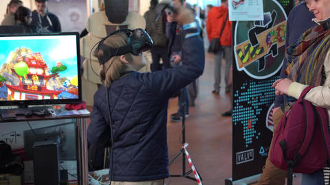 Minsk, Belarus - May 13, 2017: Child with glasses of virtual reality playing a Footage