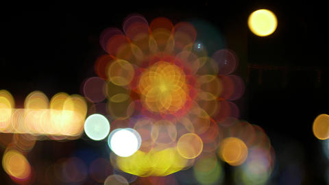 Glowing light circles out of focus at night bokeh effect Footage