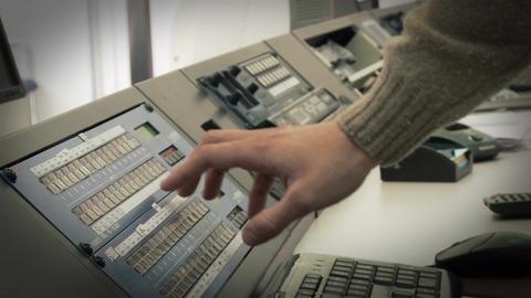 Operator On A Console At A Satellite Station Acción en vivo