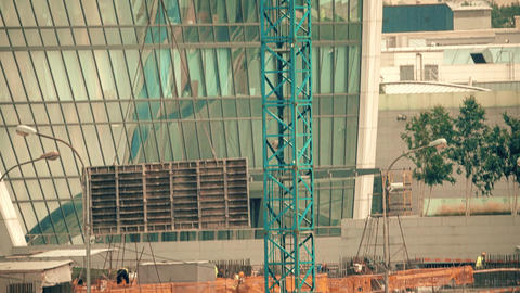 Tower crane at a modern office skyscraper construction site Footage