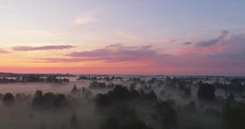 Aerial view flying over beautiful countryside fields through mysterious fog Footage