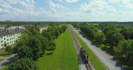 Short freight train transporting moving across the country. Aerial footage Footage
