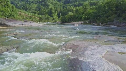 Quick Motion Low above Mountain River Foamy Rapids Live Action