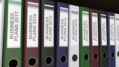Office binders with Business plans tags different years Footage
