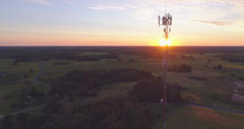 Aerial drone shot of a telecommunication radio tower mast in residential area Footage