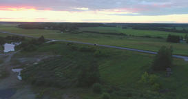 Aerial view. Car Driving on Country Road at dusk with headlights Footage