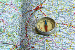 Compass and map roads Photo