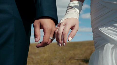 Wedding hand hold bokeh shot Archivo