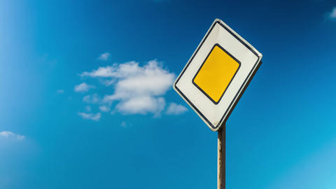 Road traffic control sign. Rules of the road, the main road. Car traffic. Sign Live Action