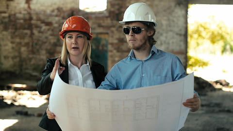 architect builder engineer builder of ruined building looking girl work plan for Footage