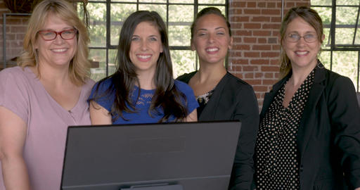 Portrait of four attractive successful professional entrepreneur women smiling Footage