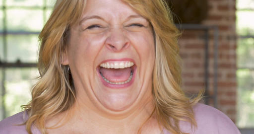 Happy woman laughing out loud lol cracking up and being hysterical at something Live Action