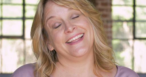 Lovesick happy smiling woman batting her eyelashes blinking and flirting Footage