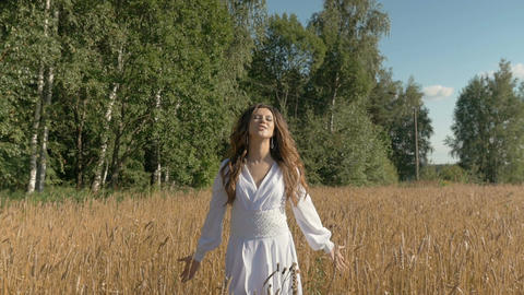 Beautiful young white woman singing with happiness on the field with wheat Footage