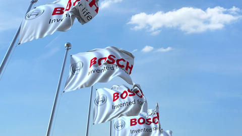 Waving flags with Bosch logo against sky, seamless loop. 4K editorial animation Live Action