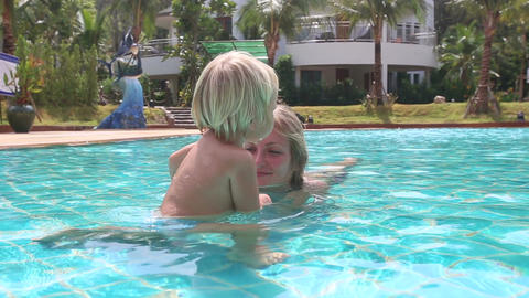 Blonde Mother Plays with Daughter in Pool Footage