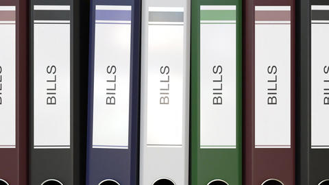 Multiple office folders with Bills text labels Live Action