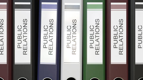 Multiple office folders with Public relations text labels Live Action