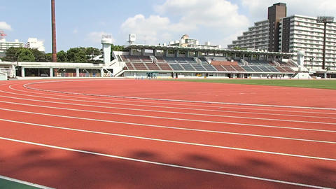People jog at athletic stadium Live Action