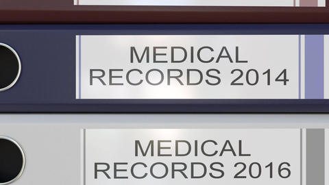 Vertical stack of multicolor office binders with Medical records tags different Footage