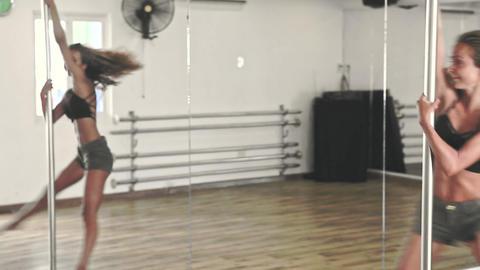 Girl with Lush Hair Revolves around Pylon in Empty Studio Footage