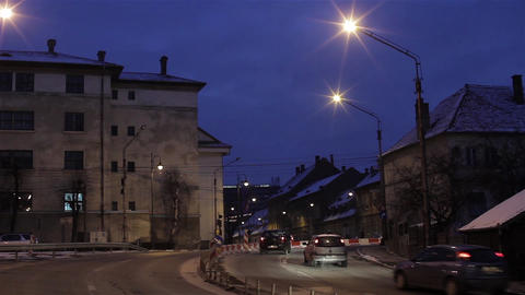 Auto traffic in the middle of a city on the brink of night, when a flock of crow Footage