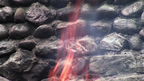 An old wall of stone, found in woods and beside him a consuming fire 1 Live Action