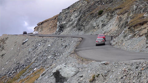 Cars driving up winding mountain side road 109 Footage