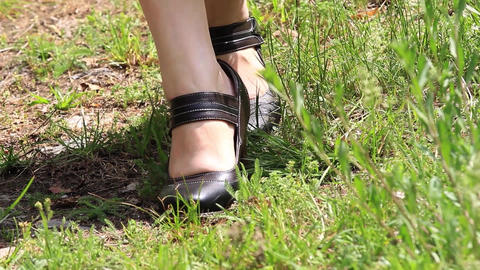 Girl dressed in folk costumes. The legs of a girl wearing shoes with heel strap  Footage