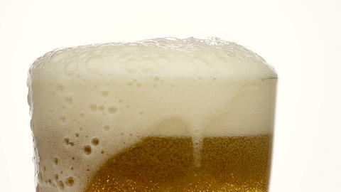 Glass of beer close-up with froth Live Action