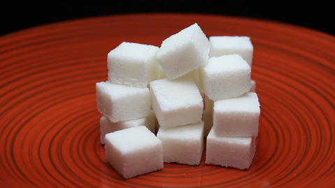 Sugar Cubes on a Red Plate Rotating Footage