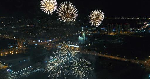 Firework streaks in the night sky. Aerial view Footage