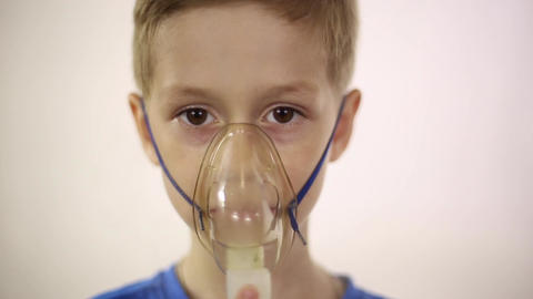 The boy in the mask the inhaler is treated Footage