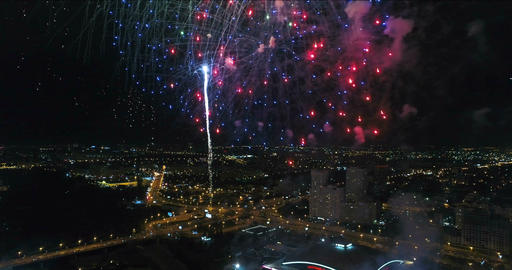 Fireworks over the evening city. Aerial view Image