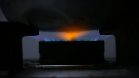 Close up shot start ignition burning gas stove and blue fire with dark and grain Footage