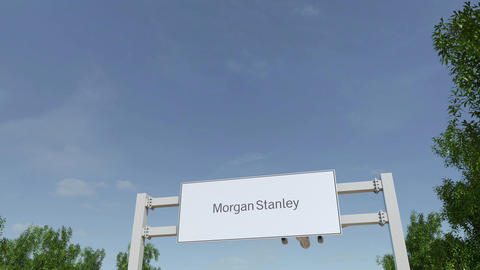 Airplane flying over advertising billboard with Morgan Stanley Inc. logo Footage