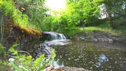 Slider shot of waterfall cascade on river. Summer landscape Footage