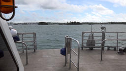 Bermuda Royal Naval Dockyard fast ride through island landscape with ferry boat Footage