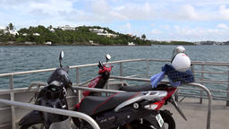 Bermuda motorbikes on Hamilton ferry that comes from Royal Naval Dockyard Footage