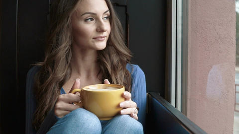 Attractive woman drinking coffee Footage
