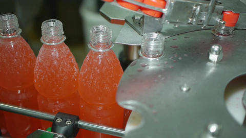 automatic screw cap on a bottle of soda mineral water, lemonade automatic Footage