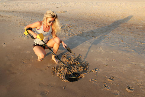 blonde girl in sunglasses with metaldetector Photo