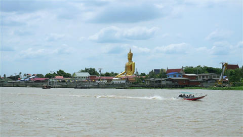 Golden buddha at Chao Phraya waterfront in Thailand Footage