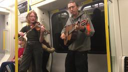 Buskers on London Underground metro train London UK 画像