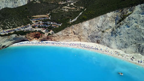People and sunbeds on the beach at Porto Katsiki in Lefkada, Greece Footage