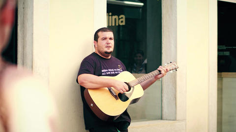 PULA, CROATIA - AUGUST 4, 2017. Guitarist playing and singing in the street Footage
