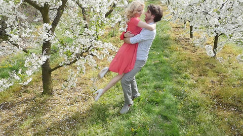 Cheerful couple enjoying a leisure time in the orchard Footage
