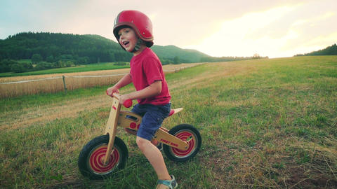 Little boy riding a retro bicycle Footage